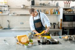 Chef is making thin dough with special machine, toned image Royalty Free Stock Images