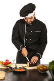 Chef male cutting eggplant Royalty Free Stock Images