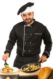 Chef male garnish vegetables Stock Images