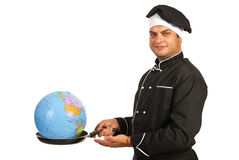 Chef male with world globe into pan Royalty Free Stock Photography