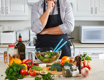 Chef man cooking in the kitchen. Royalty Free Stock Image