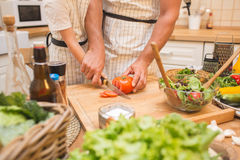 Chef man cooking on the kitchen with little son. Royalty Free Stock Photo