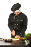 Chef man cutting vegetables Royalty Free Stock Image