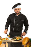 Chef man decorate food on plate. Isolated on white background Royalty Free Stock Image