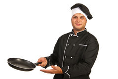 Chef man with empty frying pan Stock Image