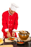 Chef man garnish plate with food Royalty Free Stock Image