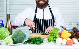Chef man in hat. Secret taste recipe. Dieting and organic food, vitamin. Healthy food cooking. Vegetarian. Mature chef royalty free stock photography