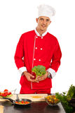 Chef man holding brocolli Royalty Free Stock Photo