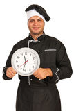 Chef man holding clock Stock Images
