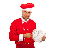 Chef man indicate to clock Royalty Free Stock Photography