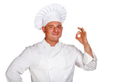 Chef man isolated over white background. Stock Image
