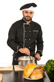 Chef man with pot with soup Stock Photo