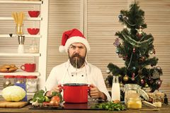 Chef man in santa claus hat cooking. Family dinner and new year recipe. Thanksgiving day and Christmas. Christmas cookies at man cook in kitchen. New year stock image