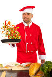 Chef man tossing vegetables Stock Photos
