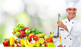 Chef man with vegetables and fruits. royalty free stock image
