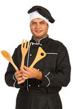 Chef man with wooden utensils Stock Photography