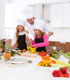 Chef master and junior pupil kid girls at cooking school Royalty Free Stock Photography