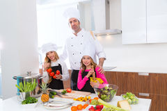 Chef master and junior pupil kid girls at cooking school royalty free stock image