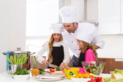 Chef master and junior pupil kid girls at cooking school Stock Photo