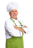 Chef. Mature professional chef man. Isolated over white background royalty free stock photo