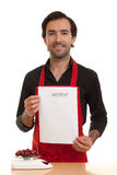 Chef menu. A chef holding an empty menu in front of him stock photos