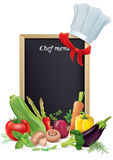 Chef menu board and vegetables Royalty Free Stock Photo