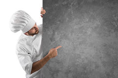 Chef menu. Chef showing and indicates his menu on a grey billboard stock images
