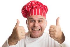 Chef mit dem roten Hut, der Ausdr?cke macht lizenzfreies stockfoto