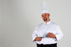 Chef mit Messer Stockfotografie