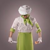 Chef mit Messer und Küchenspachtel Stockfoto