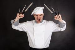 Chef mit Messern Stockbild