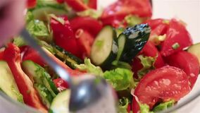 Chef mix lettuce green salad in glass bowl stock video footage