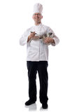Chef mixing. Male chef smiling with mixing bowl on white stock photography