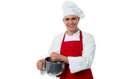 Chef mixing batter, isolated on white Stock Images