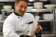 Chef mixing food Royalty Free Stock Photos