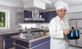 Chef in modern kitchen Royalty Free Stock Image