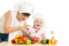 Chef mom and kid prepare healthy food Stock Photo