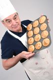 Chef with Muffins Royalty Free Stock Image