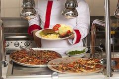 Chef near buffet Stock Photo