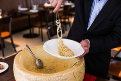 Free Chef Neatly Plating Spaghetti Carbonara In Cheese Wheel On White Plate Royalty Free Stock Image - 115076286