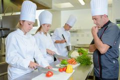 Chef observing the students. Man royalty free stock photos