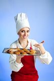 Chef offer fresh biscuit. Happy chef offer tray with fresh oat biscuit Royalty Free Stock Photo