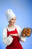 Chef offer tasty cookies. Happy woman chef offer cookies straight from oven Royalty Free Stock Images