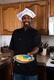 Chef offers Cookies Royalty Free Stock Image