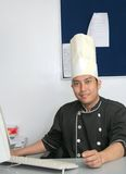 Chef in office Stock Images
