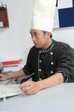 Chef in office Royalty Free Stock Photos