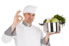 Chef with OK sign and holding pot with vegetables. Stock Photography