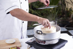 Chef opening lid of basket bamboo Stock Photo