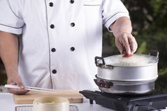 Chef opening the pot Royalty Free Stock Images