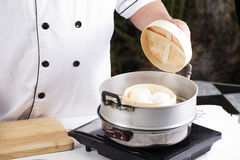 Chef opening the pot Royalty Free Stock Photos